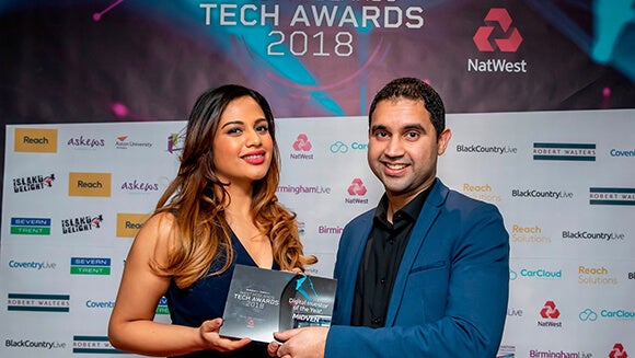 Ahsan Iqbal, director of Technology at Robert Walters with Digital Investor of the Year winners Midven, represented by Aanisah Begg.
