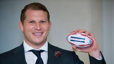 Dylan Hartley holding a rugby ball