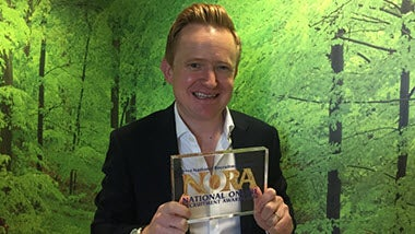 UK Marketing Director Steve Coxall accepts the NORA