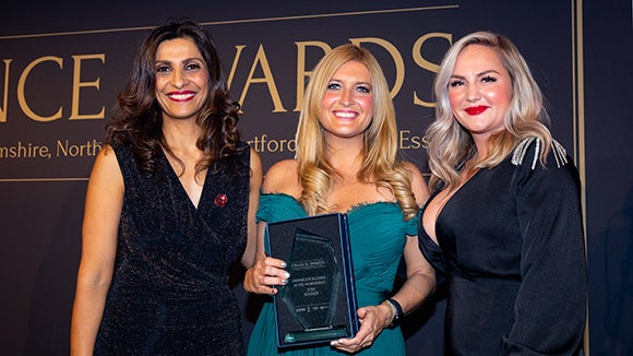 Finance Awards winner with host and judge