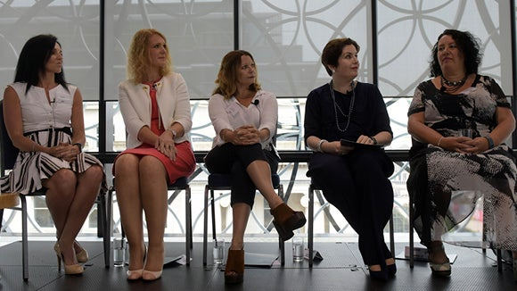 panel of five women sitting on stage discussing employee retention techniques