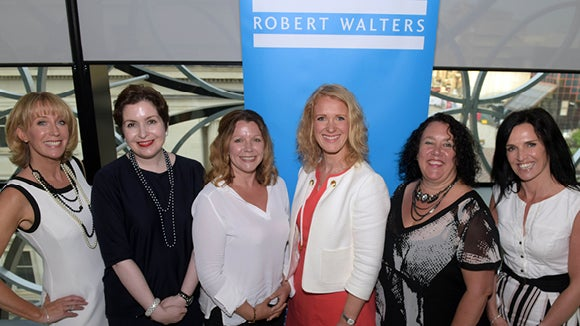 panel of women from robert walters event standing in front of blue robert walters sign in midlands