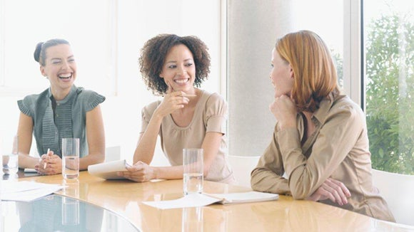 three women sitting around a table discussing diversity initiatives