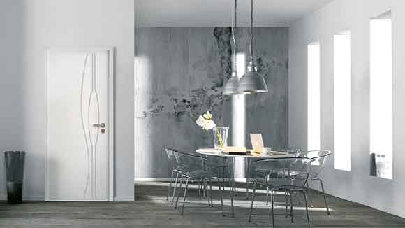 glass table and white door by JELD-WEN in a dining room