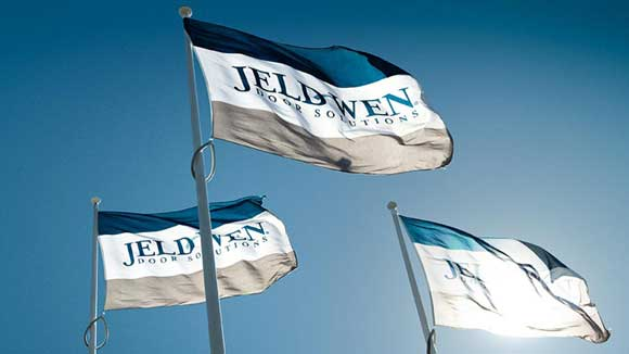 JELD-WEN flags flying in the air outside of their office