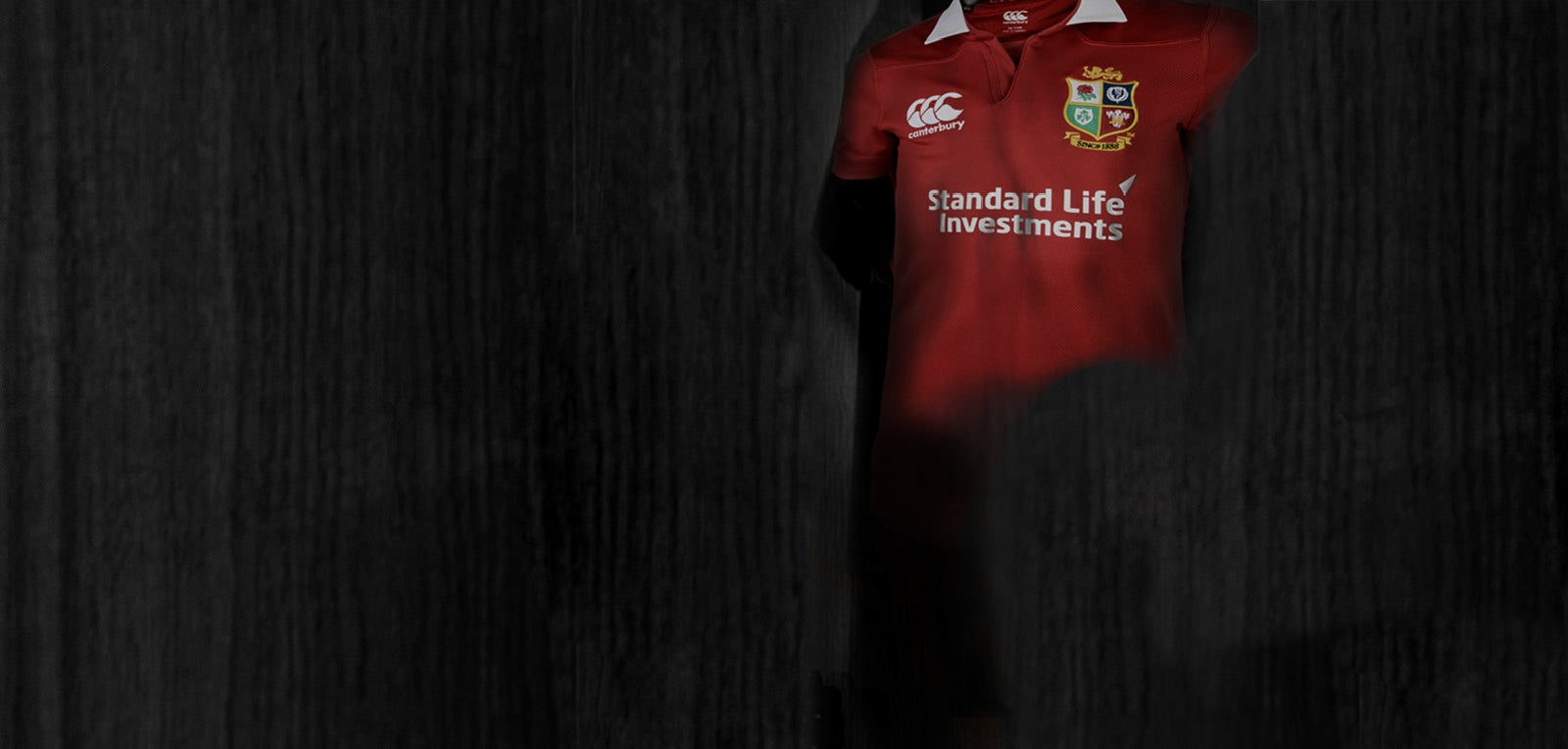 Black background with British Lions Rugby Shirt in top right corner