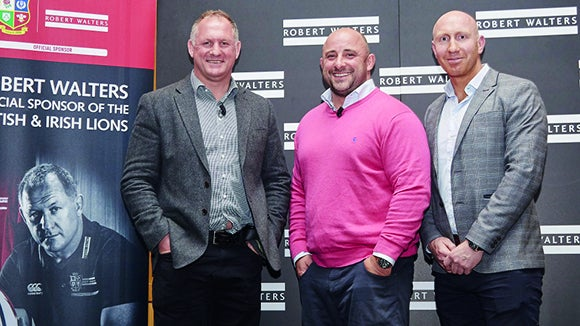 three former rugby legends standing next to the robert walters logo at an event in Manchester