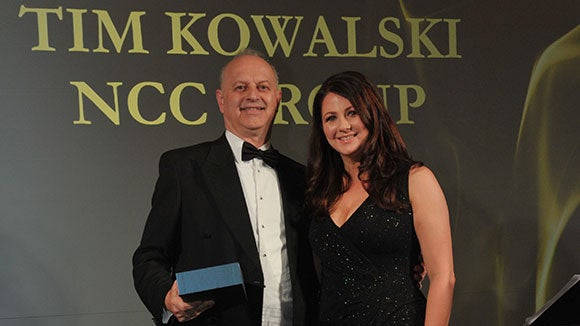 Tim Kowalski, winner of North West finance awards lifetime achievement posing with robert walters director for finance lucy bissett in manchester