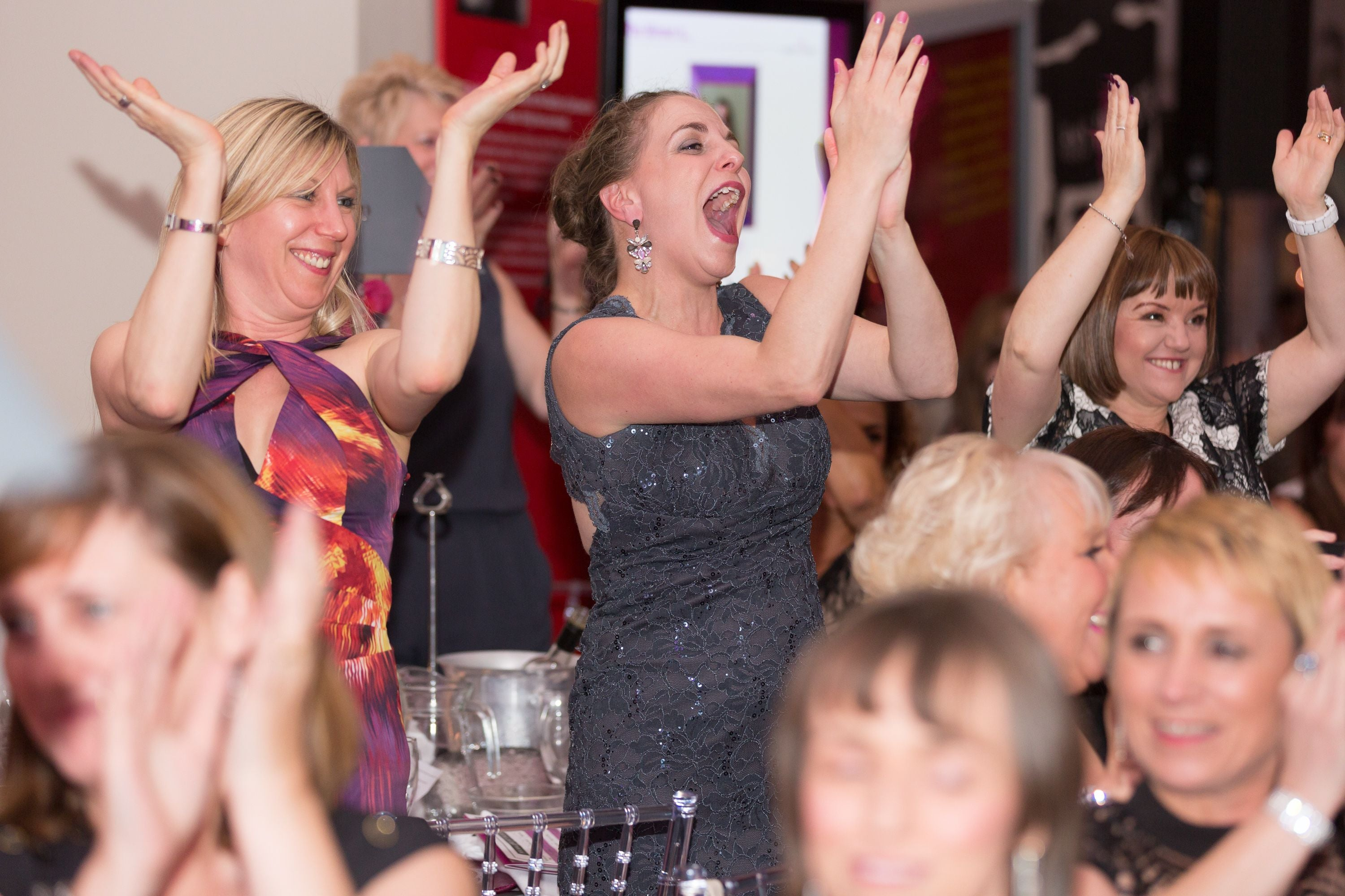women celebrating with arms in the air at the 2015 manchester pa of the year awards