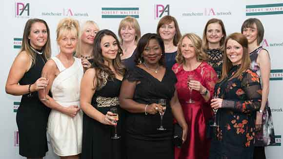 women celebrating at the manchester pa of the year awards in front of media board