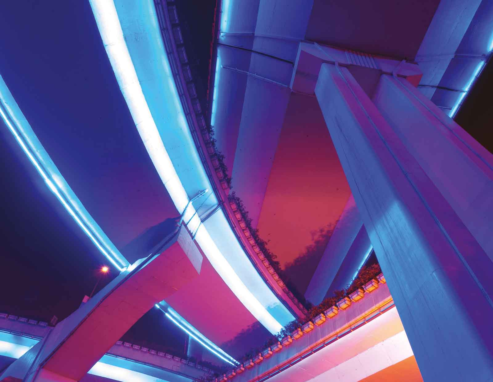 bright blue and pink highway image shot from underneath