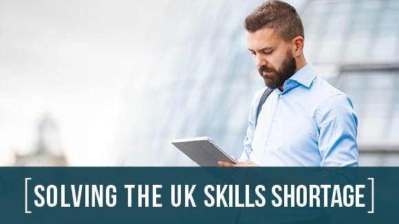 Solving the UK Skills Shortage banner image with green bar and two people discussing research results