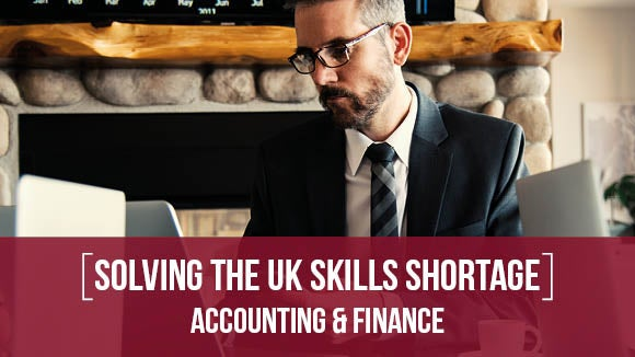 man on laptop downloading solving the uk skills shortage accounting & finance