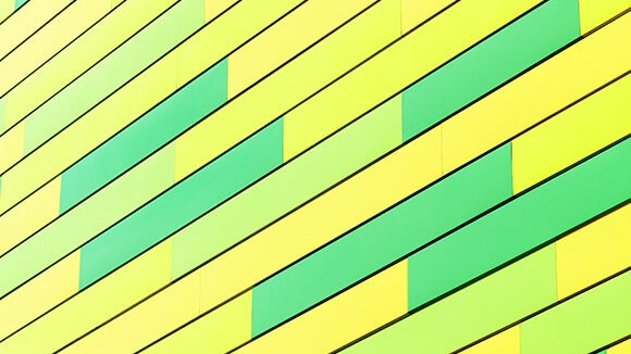 Green and yellow building tiles at an angle