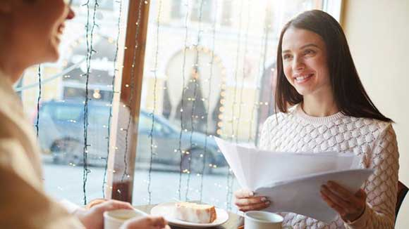woman in coffee house looking at ways to avoid bad hires