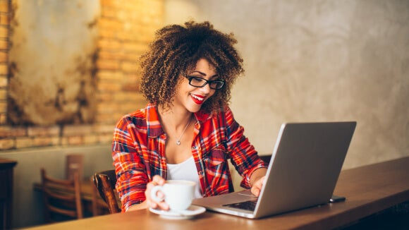 woman working on personal brand statement on laptop
