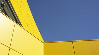 Sky and yellow building for treasury professionals in the Middle East