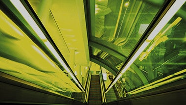 escalator with green filter behind future proof your career in tax text