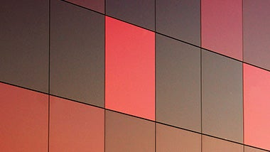 red and black squares on a building behind accounting and finance jobs text