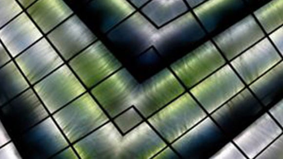 textured glass ceiling with green and grey behind find out what you're worth text